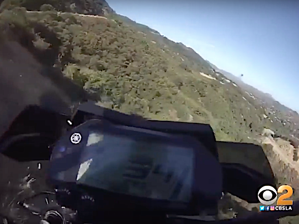 Video: On-board as motorcyclist rides off cliff